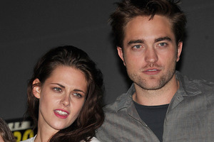 Robert Pattinson is reportedly recovering from Kristen Stewart's betrayal by chatting to strangers in his hotel and playing computer games. Photo / AP