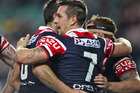 The Sydney Roosters celebrate a try during their win over the Dragons. Source / Getty Images