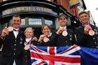 New Zealand's Mark Todd, Jonelle Richards, Caroline Powell, Jonathan Paget and Andrew Nicholson celebrate winning bronze in the eventing. Photo / Brett Phibbs