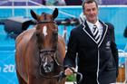 New Zealand's Mark Todd runs Campino through the trot-up before the eventing show jumping where he has a clear medal chance. Source / Mark Mitchell