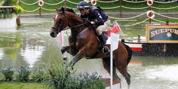 Mark Todd riding Campino leaps over the last of the water jumps during the individual eventing cross country. Photo / Mark Mitchell