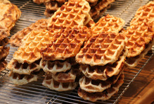Authentic  Belgian waffles are butter-rich, with a hint of cinnamon, and topped with caramelised sugar.