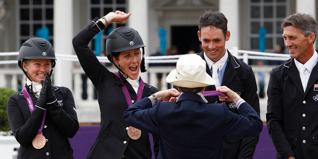 Caroline Powell, is jubilant after receiving her bronze medal from Princess Anne. Photo / Brett Phibbs