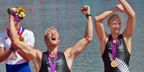 Eric Murray and Hamish Bond celebrate after the medal ceremony. Photo / Brett Phibbs