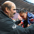  New Zealand's Valerie Adams in despair with her coach, Jean-Piere Egger, after her last throw in the Olympic Games women's shot put. Photo / Mark Mitchell