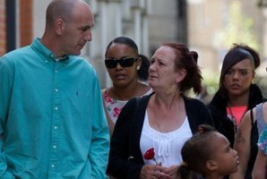 Mark Duggan's mother is comforted by relatives as they walk to a memorial service for the first anniversary of Mark's death. Photo / AFP
