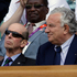Prince Edward, Duke of Kent, left, watches the gold medal match between Britain's Andy Murray and Switzerland's Roger Federer at the All England Lawn Tennis Club at Wimbledon, in London. Photo / AP