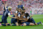 United States' Carli Lloyd, center bottom, celebrates with teammates after scoring against Japan during the women's soccer gold medal match. Photo / Ben Curtis