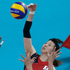 Japan's Yukiko Ebata, top, spikes the ball over Brazil's Fabiana Claudino (1) and Danielle Lins during a women's semifinal volleyball match. Photo / Jeff Roberson