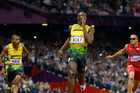 Jamaica's Usain Bolt second left, reacts as he crosses the finish line to win the men's 200-meter final. Photo / Anja Niedringhaus