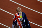 Sally Pearson of Australia celebrates after winning Gold in the Women's 100m Hurdles Athletics. Photo / Brett Phibbs