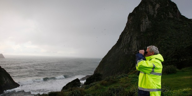 Three climbers are missing after falling in the sea at New Plymouth's Paritutu Rock today (centre). Photo / Rob Tucker