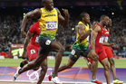 Jamaica's Usain Bolt blitzes the field on his way to taking the gold medal in the Olympic Games 100m final at Olympic Stadium Olympic in London. New Zealand Herald Photograph by Mark Mitchell.