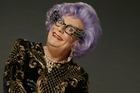 A glittering and bejeweled Dame Edna, the alter ego of Barry Humphries, enthusiastically greeted city representatives and media at the Town Hall, saying she was delighted to be back in the country and for her last farewell tour. Deputy Mayor Penny Hulse and Dame Edna's long-time friend, gossip columnist David Hartnell, were among the gathered group.