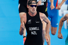 New Zealand's Kris Gemmell leads fellow Kiwi Bevan Docherty into the run stage of the Olympic Games men's triathlon. Photo NZ Herald/Mark Mitchell.