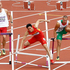 China's Liu Xiang, center, falls as Poland's Artur Noga, left, and Hungary's Balazs Baji, right, react during a men's 110-meter hurdles heat during the athletics. Photo /AP