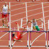China's Liu Xiang, second left, falls as Hungary's Balazs Baji, Poland's Artur Noga and Barbados' Shane Brathwaite and Senegal's Moussa Dembele react during a men's 110-meter hurdles heat. Photo / AP