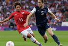 USA's victory over Japan in the women's gold medal football last night was marred by a slew of racist tweets. Photo / AP