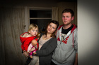 Kim and Isaac Allison with 2-year-old Alice, say their home is cold and damp.