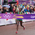 Ethiopia's Tiki Gelana crossing the line to take the gold medal in the Olympic Games women's marathon. Photo / Mark Mitchell.