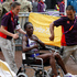 Namibia's Beata Naigambo is moved in a wheelchair after finishing the Olympic Games women's marathon in London. Photo / Mark Mitchell