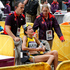 South Africa's Rene Kalmer is moved in a wheelchair after finishing the women's marathon. Photo / Mark Mitchell.