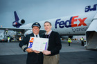 Captain Bear Kramer delivering the first package to Kim Garner, Managing Director FedEx Express Australasia. Photo / Supplied