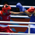 New Zealand women's boxer Alexis Pritchard ( in Red ) during the bout against Rim Jouini of Tunisia. Photo / Brett Phibbs.