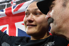 A tearful Valerie Adams is comforted by coach Jean-Pierre Egger. Photo / Mark Mitchell