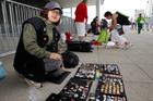 Linda Li, of China, trades pins at Stratford International Station, next to Olympic Stadium. Photo/ Mark Mitchell