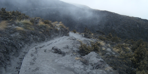 Ash covers a walkway on the Tongariro crossing. Photo / Supplied