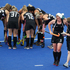 New Zealand Black Sticks player Katie Glynn is assisted from the pitch. Photo / Brett Phibbs.