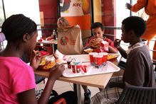 The arrival of KFC in Nairobi has been regarded as a milestone in the rise of Kenya's middle classes rather than a cause for health concern.  Photo / AP