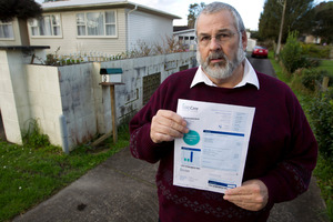 Gary Osborne of Henderson with his property's water bill.  Photo / Steven McNicholl