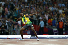 Usain Bolt celebrates winning the 200m final, the first sprinter to win both the 100m and 200m races at two consecutive games.Picture / AP