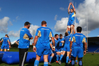 Kieran Read is lifted during lineout drills by the All Blacks at Trusts Stadium yesterday. Picture / Getty Images