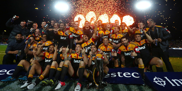 Chiefs players celebrate their Super Rugby victory last night. Photo / Getty Images