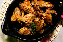 Lemon and rosemary roasted chicken wings. Photo / Babiche Martens
