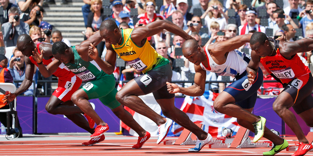 Jamaica's Usain Bolt (wearing yellow) in a 100m heat at the Olympics. Photo / AP