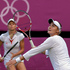 Nadia Petrova, right, and Maria Kirilenko, of Russia, play against Venus and Serena Williams. Photo / AP.