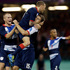 Britain's Aaron Ramsey celebrates his goal with teammates Craig Bellamy, middle, and Tom Cleverley, left. Photo / AP.