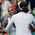 United States' Serena Williams, left, hugges Venus Williams after defeating Maria Kirilenko and Nadia Petrova, of Russia, for the women's doubles semifinal match. Photo / AP.