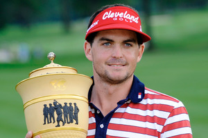 Keegan Bradley holds the trophy after winning the Bridgestone Invitational. Photo / AP
