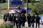 Police walk near the Sikh Temple of Wisconsin in Oak Creek. Photo / AP
