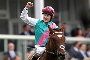 Tom Queally celebrates his victory on Frankel in the Queen Anne Stakes during day one of the 2012 Royal Ascot meeting. Photo / David Davies