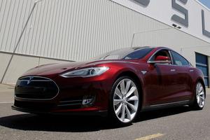 Another Tesla Model S rolls off the production line. Photo / Paul Sakuma Photo / Paul Sakuma