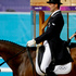 A judge at right looks on as Mark Todd of New Zealand, and his horse Campino, compete in the equestrian eventing dressage phase. Photo / AP.