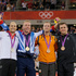 Gold medalist Chris Hoy, second from left, poses for photos with Silver Medalist Maximilian Levy, of Germany, and Bronze medalists Simon van Velthooven, of New Zealand, right. Photo / AP.