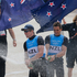 Peter Burling and Blair Tuke of New Zealand spray champagne to celebrate their silver medal. Photo / AP.