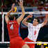 Poland's Zbigniew Bartman (9) and Russia's Taras Khtey (4) watch the ball balance on the net during a men's volleyball quarterfinal. Photo / AP.